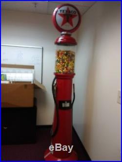 Gumball machine 7'6ft Texaco Gas Pump machine. Takes quarters, do not have key